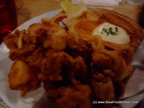 Crisp-fried baby squid with alioli and lemon