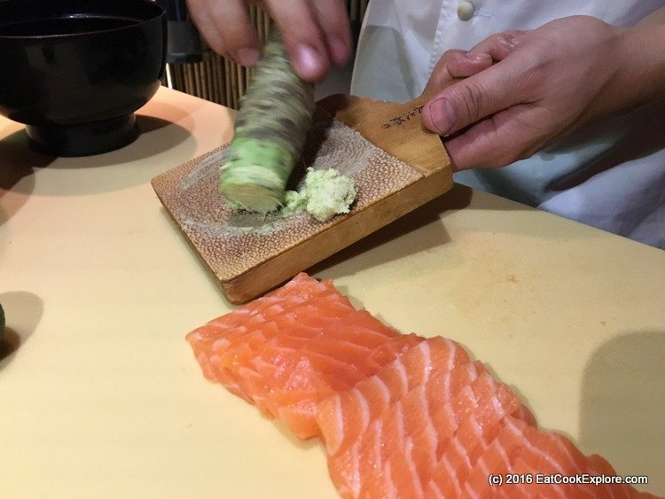 Grating fresh wasabi for the salmon sushi