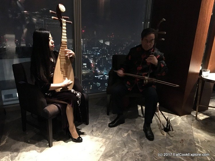 Ting Serenaded by traditional Chinese music