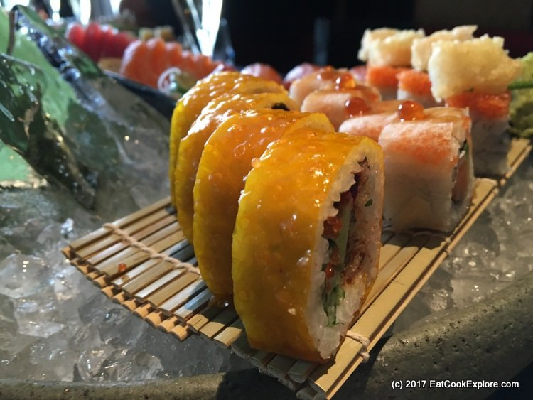 Sushi Maki wrapped with their yellow mango flavoured skin