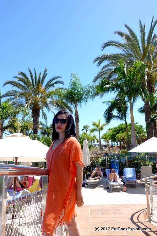 Seafolly cover up in orange and sunglasses by the pool at Gran Anfi Resort, Gran Canaria