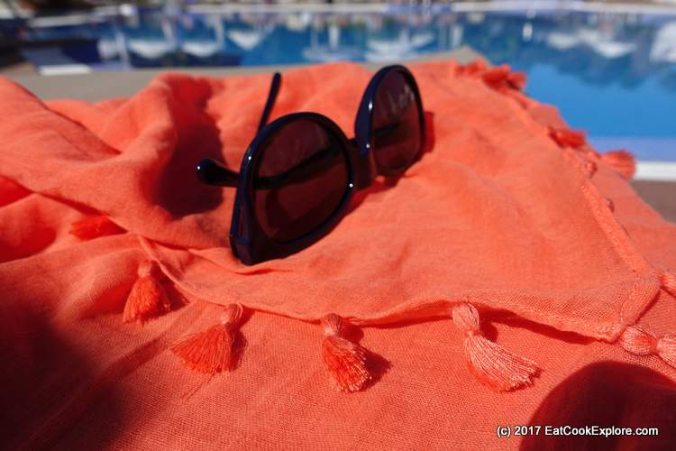 Seafolly cover up in orange and sunglasses