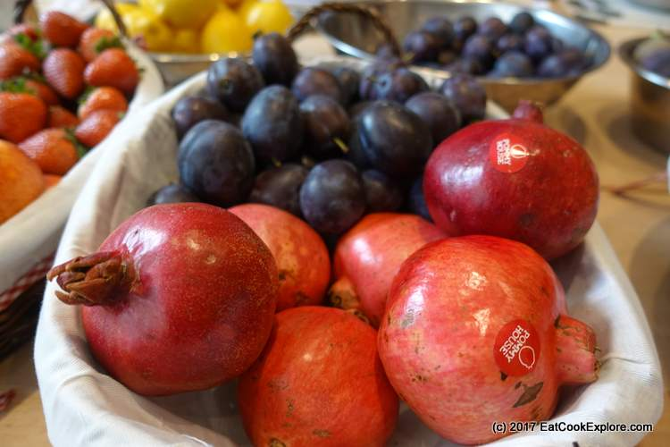 Making Jam with seasonal fruits pomegranate and plums
