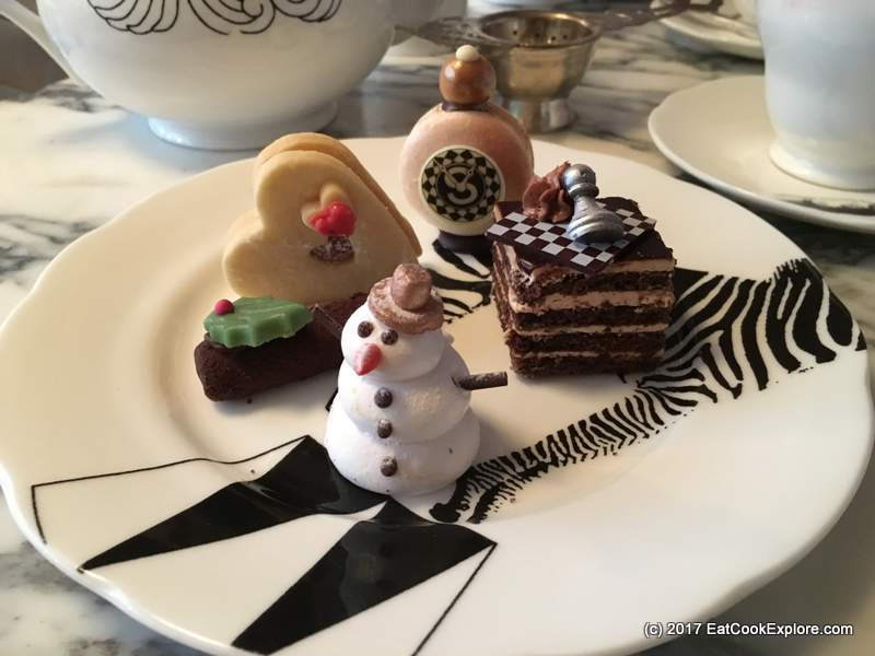 Mad Hatters Afternoon Tea Sanderson Hotel Marshmallow snowman, shortbread, mocha chessboard gateau and with the Mad March Hare vanilla pocket watch macaroon