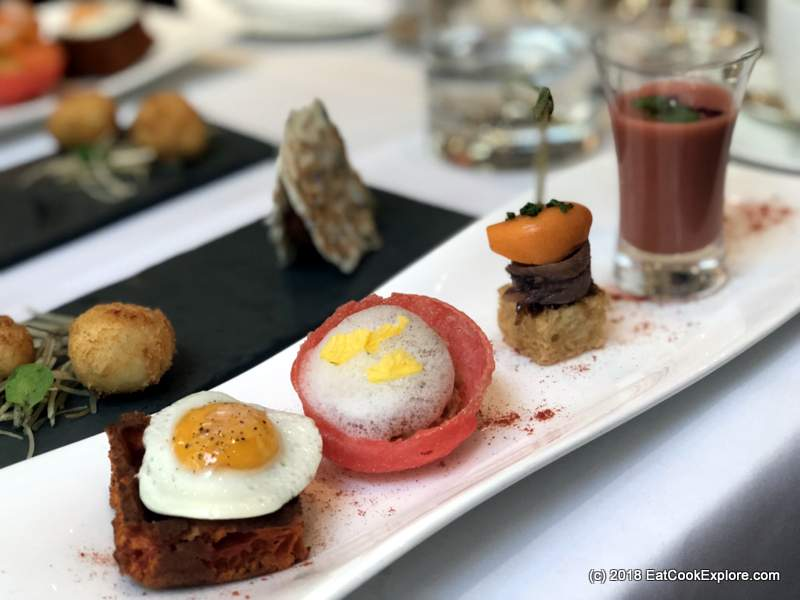 The Halkin Afternoon Tea Savoury waffle with a little quails egg, Txangurro spider crab, tomato and raspberry soup