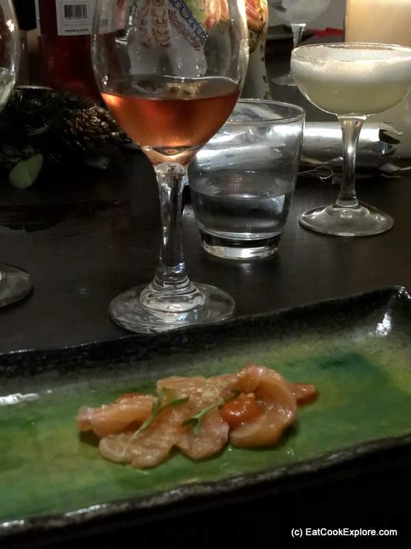 Salmon Tiradito Salmon sashimi, rocota sauce, camu camu, dry Inca corn