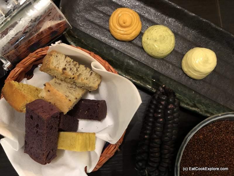 Pan rustico Quinoa, Aji Amarillo and Purple corn breads Huacatay and rocoto Butter
