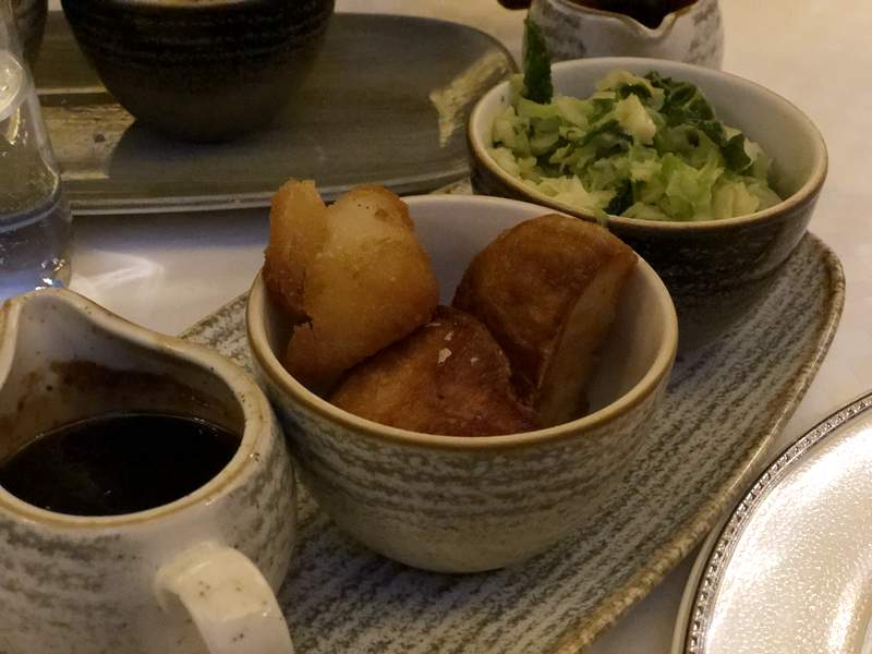 Roast potatoes and savoy cabbage